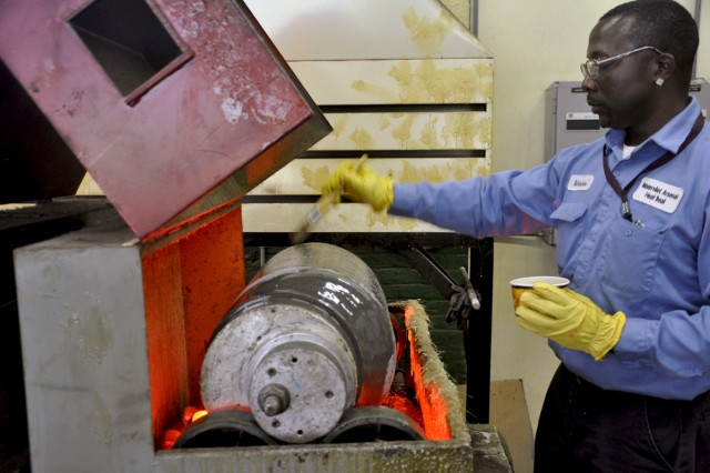 Metal Processor Work Leader Marvin Hunter working on bore evacuators for the Abrams tank system.  For decades, the arsenal has manufactured bore evacuators for the Abrams tank system and now, the arsenal will add 155 mm bore evacuators to its product line.