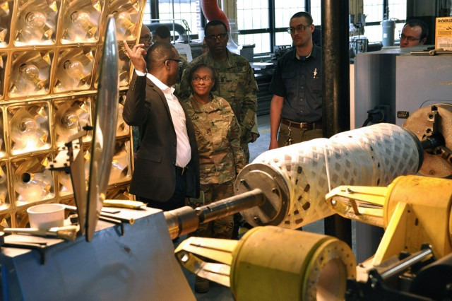 Metal Processor Work Leader Marvin Hunter explaining the bore evacuator manufacturing process to former TACOM LCMC Commander, Maj. Gen. Gwen Bingham, during her final visit to Watervliet in April 2016.  For decades, the arsenal has manufactured bore evacuators for the Abrams tank system and now, the arsenal will add 155 mm bore evacuators to its product line.