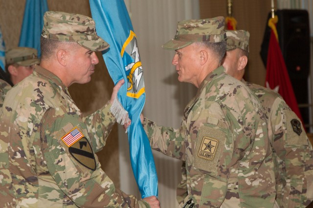 Maj. Gen. Christopher S. Ballard (left) accepts the guidon from Lt. Gen. Robert P. Ashley Jr., U.S. Army deputy chief of staff for intelligence (G2), symbolizing the official passage of command of the U.S. Army Intelligence and Security Command (INSCOM) from Maj. Gen. George J. Franz III to Ballard, during a ceremony at the Fort Belvoir Community Center, June 27. (U.S. Army photo by Jocelyn Broussard)