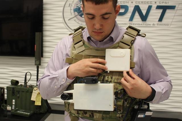 Eric Bickford, U.S. Army CERDEC engineer, compares the current prototype vision-aided navigation system with a 3-D rendition of a planned smaller, more Soldier-wearable system. CERDEC engineers are analyzing the systems as a possible emerging and alternative navigation technologies for future combat operations.