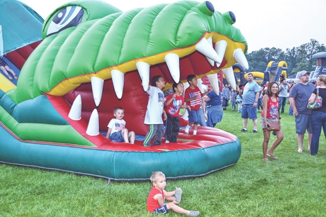Children enjoy inflatables during last year's celebration at Gammon Field.