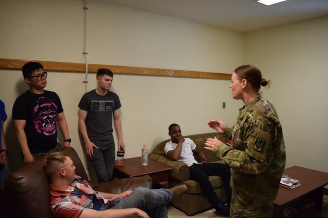 Staff Sgt. Tiffany Harrison, right, Brigade Victim Advocate, Headquarters and Headquarters Battery, 35th Air Defense Artillery Brigade, conducts an after-action report with Soldiers from C and D Batteries, 6th Battalion, 52nd Air Defense Artillery Regiment, and HHB, 35th ADA Brigade, after completing a realistic training scenario during Sexual Harassment/Assault Response & Prevention 360 Degree Training hosted by U.S. Army Garrison-Camp Humphreys, June 23, 2016. (Courtesy Photo)
