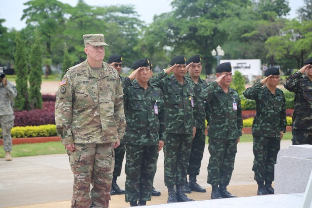 Brigadier General Brian Alvin, Deputy Commanding Gereral, U.S. Army Reserve, participates in the wreath laying by soldiers from the Royal Thai Army,  June 27, 2016 on Fort Adisorn prior to the opening ceremony for Exercise Hanuman Guardian, part of Pacific Pathways. Hanuman Guardian is a joint U.S. - Thai exercise focused on military interoperability while providing disaster relief. (U.S. Army Photo by Pfc. Judge Jones)
