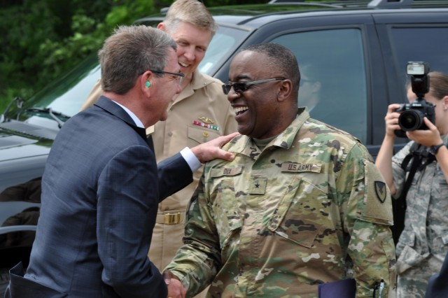Brig. Gen. Richard Dix, commanding general of Joint Munitions Command, greets Secretary of Defense Ashton Carter as he lands at Naval Support Activity, Crane for a historic visit on June 22. This was both Dix and Carter's first time visiting NSA, Crane Division.