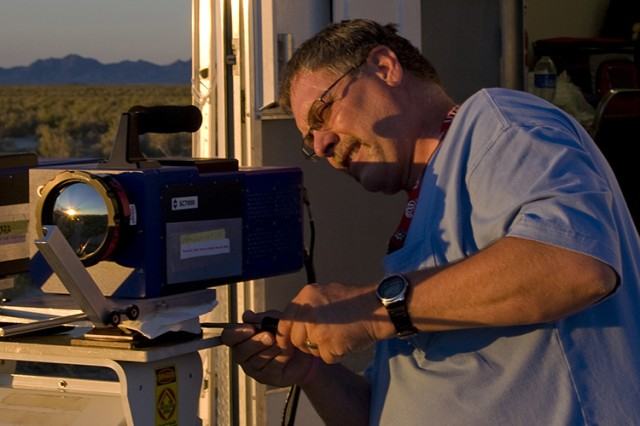 A Dugway optical technician prepares a Forward Looking Infrared (FLIR) camera that will track a release of simulated biological agent at night. Dugway provides its referee data to participants, to compare against their own data. (Photo by Al Vogel / Dugway Public Affairs)