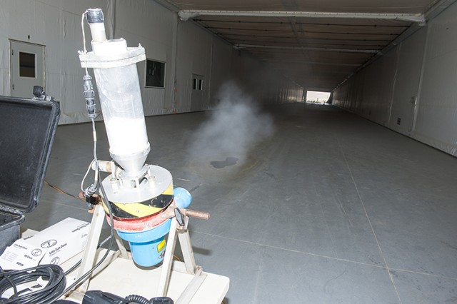 Simulated biological agent is disseminated inside the 550-foot-long Joint Ambient Breeze Tunnel to defense technology at the other end, in this 2015 photo. Within a short distance, biological or chemical agents become unseen but remain deadly threats for some distance. (Photo by Jim Robertson / Dugway Test Support)