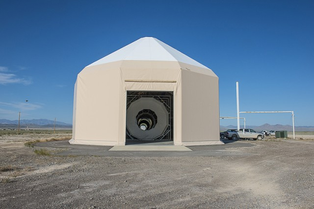 "The 440-foot-long exterior of the Active Standoff Chamber contains a 110-foot-long chamber that holds airborne simulants in place with ""walls"" created with downward air. The air won't interfere with the laser beam of standoff detectors that detect from a distance. (Photo by Jim Robertson / Dugway Test Support)"