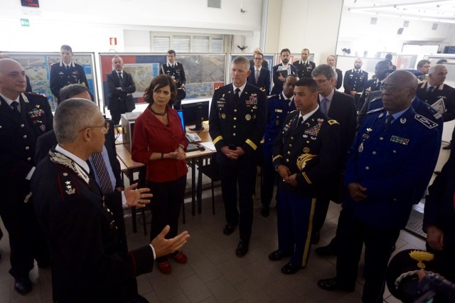 (From center left) Laura Boldrini, Speaker of the Chamber of Deputies of the Italian Parliament; Maj. Gen. Joseph Harrington, commanding general of U.S. Army Africa; Col. Darius Gallegos, deputy director of the Center of Excellence for Stability Police Units; and Gen. Mamadou Gueye Faye, the commander of Senegal's gendarmerie forces, receive a briefing from CoESPU staff June 17,  on future exercises to be held in Vicenza, Italy. The exercises are part of an initiative by the Organization for Security and Co-Operation in Europe aimed at reducing human trafficking along migration routes, and will involve some 200 European and African participants.   (U.S. Army Africa photo)