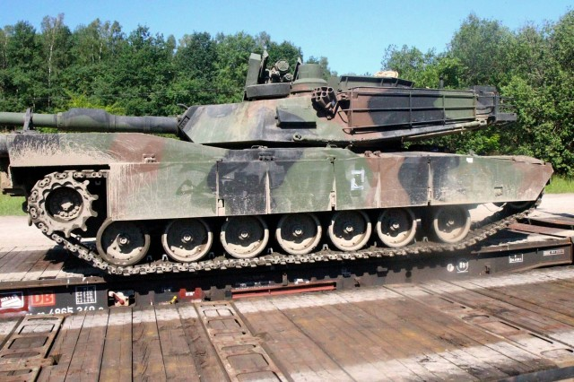 Soldiers from 3rd Battalion, 69th Armor Regiment load a U.S. Army M1A2 Abrams Main Battle Tank onto a railcar at Drawsko Pomorskie Training Area, Poland June 21. Tanks and Bradley Fighting Vehicles are being moved to the Baltics as the 1st Armored Brigade Combat Team, 3rd Infantry Division takes over the Operation Atlantic Resolve mission in Estonia, Latvia and Lithuania, July 1, after previously taking over the mission in Poland, May 1.