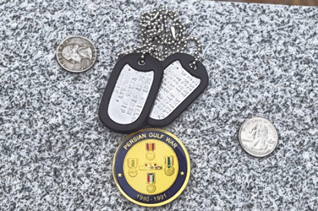 Artifacts began appearing on the Desert Storm Memorial Stone immediately after the unveiling ceremony Friday in Memorial Grove.