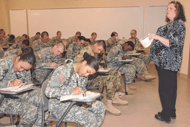 Tammy Fink, ACS financial readiness specialist, speaks to a group of Soldiers about the Military Saves Campaign in February.