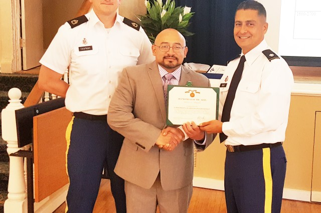 Marlon Zambrano, quality management chief at Madigan Army Medical Center's California Medical Detachment, received the Commander's Award for Civilian Service for winning the 2015 Regional Health Command-Pacific Civilian of the Year. CALMED's Sgt. 1st Class Kyle Chapman and Lt. Col. Bill Soliz, commander, presented Zambrano with the award.
