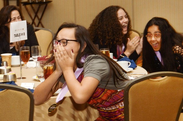 "Members of ""Las Chicas de Puerto Rico"" react as their name is called as a national winner of this year's eCYBERMISSION. Team members Bria Roettger, Janat Khan, Janeliz Guzman Acevedo and Luz Figueroa-Rodriguez investigated the effects of Saharan dust levels on local respiratory issues and how to create an effective warning system for people who suffer from asthma in Puerto Rico."