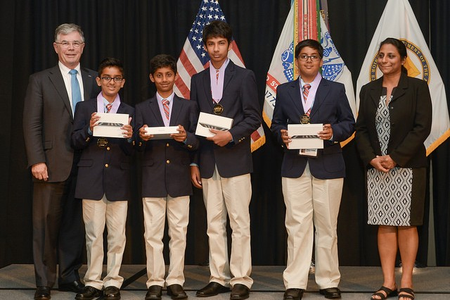 "The People's Choice Award, voted by an online audience of more than 10,000 eCYBERMISSION viewers, was won by ""Pandanet,"" a sixth grade team from Greenbriar West Elementary School in Fairfax, Virginia.  Team members Siddharth Krishnan, Aarav Bajaj, Aryan Kumawat and Siddharth Tibrewala each received iPad minis for their win.  Team advisor is Meera Krishnan. Presenting the award was Dr. David L. Evans, left, executive director of the National Science Teachers Association."