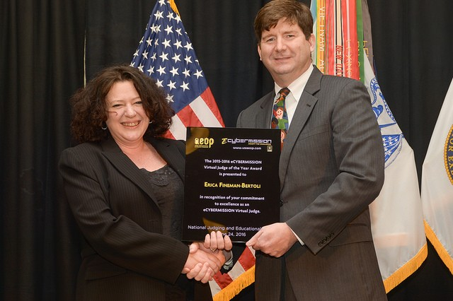 Erica Bertoli, from the Army Communications-Electronics Research, Development and Engineering Center, receives the eCYBERMISSION Virtual Judge of the Year from Jeffrey Singleton, Director for Basic Research, Office of the Secretary of the Army (Acquisition, Logistics & Technology).  Bertoli serves as team lead for CERDEC's Educational Outreach Program where she leads a year-round STEM program serving 8,000 students across Harford and Cecil counties in Maryland.  Bertoli was recognized for her efforts in reviewing 122 eCYBERMISSION Mission Folders as well as encouraging fellow virtual judges throughout CERDEC.  She also served as emcee for the National Showcase and Awards Luncheon at this year's NJEE.