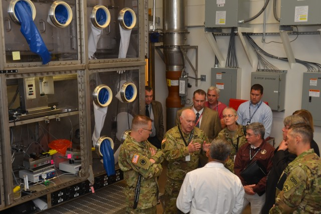 Visiting the Whole System Live Agent Test (WSLAT) facility was Maj. Gen. Brian C. Lein, commanding general, U.S. Army Medical Research and Material Command at Fort Detrick, Md., Dr. August W. Fountain acting director of research and technology, Edgewood Chemical and Biological Center and Col. Neal C. Wollen, director of biosecurity, U.S. Army Medical Research Institute of Infectious Diseases. The WSLAT is a full system BSL-3 aerosol chamber with temperature, humidity, and wind speed controls designed to challenge large items with biological agents. The chamber will be used to referee and validate point detector systems and other field biological detectors. (Photo by Bonnie A. Robinson, Dugway Public Affairs)