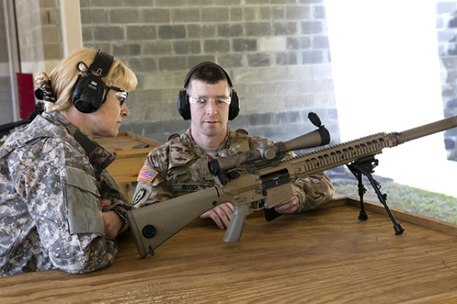 Maj. Travis Rudge, Assistant Product Manager for Small Caliber Ammunition, shows McFarland M118 7.62 mm ammunition for the M110 SASS, or Semi-Automatic Sniper System, during her visit to Picatinny June 29. Photo by Todd Mozes