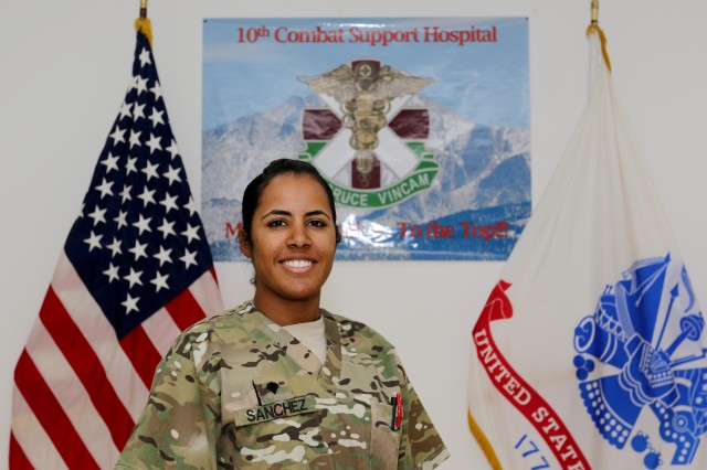 Spc. Dayanna Sanchez, a radiology specialist with the 53rd Head and Neck Surgical Team assigned at Camp Arifjan, Kuwait, and native of Havana, Cuba, poses for a picture June 28, 2016. Sanchez' hard work and dedication recently afforded her the opportunity to be the only female Soldier to participate in the USARCENT Soldier of the Year Competition.