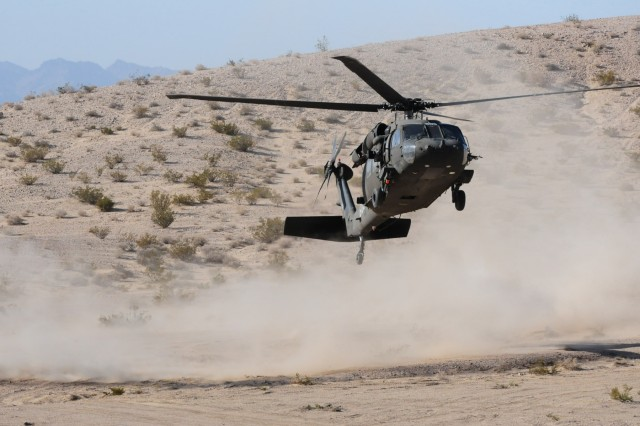 A Blackhawk helicopter with the 1st Battalion, 285th Aviation Regiment, serves as a transport - in addition to enabling air superiority - during the 1/34th ABCT's National Training Center rotation at Fort Irwin, California. (Minnesota National Guard photo by Staff Sgt. Patrick Loch)