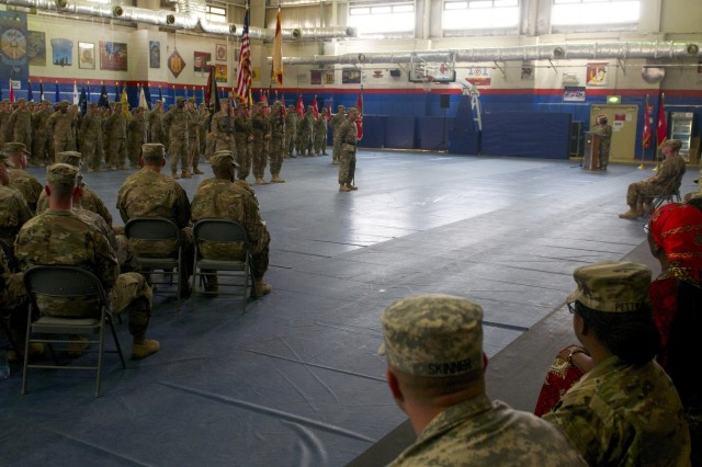 Hundreds of Soldiers came out to witness Command Sgt. Maj. Eric J. Alfieri, former Area Support Group Kuwait command sergeant major, pass the saber during a relinquishment of responsibility ceremony for Area Support Group Kuwait at Camp Arifjan, July 2.  Command Sgt. Maj. Matthew Erickson, former 682nd Engineer Battalion Command Sgt. Maj., will serve as the interim senior enlisted advisor. (Photos by Sgt. Aaron Ellerman/Released)