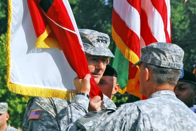 Lt. Gen. Michael S. Tucker's 44-year Army career culminated as commander of First Army, which is responsible for the training of the Reserve Component. Here, he accepts the First Army guidon from Forces Command Commanding General, Gen. Daniel B. Allyn, during an assumption of command ceremony in 2013.