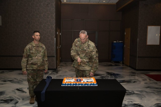 Col. Scott A. Bird, the 1st Signal Brigade Commander cuts a cake following the brigade's change of command ceremony. Bird took command June 30 and is the brigade's 31st commander.