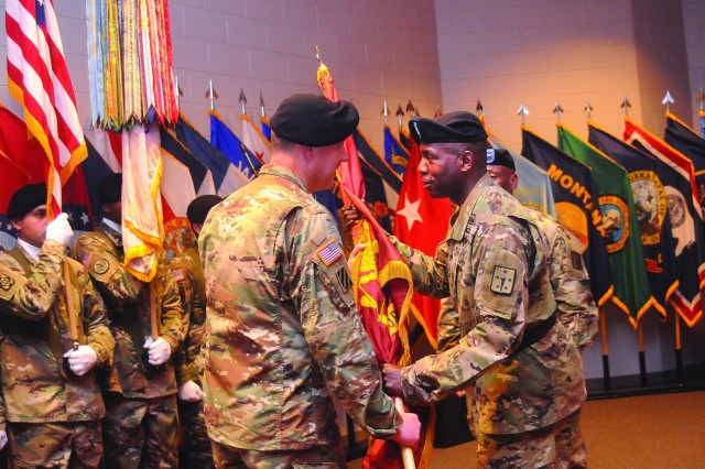 Maj. Gen. Darryl K. Williams, CASCOM and Fort Lee commanding general, passes the Transportation Corps colors to Col. Steven George during a relinquishment of command ceremony June 27 at Wylie Hall. George assumed his duties on a interim basis until an assumption of command takes place for Brig. Gen. Jeffrey W. Drushal, currently the assistant chief of staff, J-4, U.S. Forces Korea. (Photo by T. Anthony Bell, U.S. Army Garrison Public Affairs)