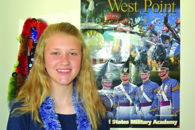 Kassidy Reed displays her West Point poster and her collection of Hawaii lays' in her room. She has hopes to be the first female in her family go to the U.S. Military Academy, West Point and black hawk pilot.(Photo by Lesley Maceyak, U.S. Army Garrison Public Affairs)
