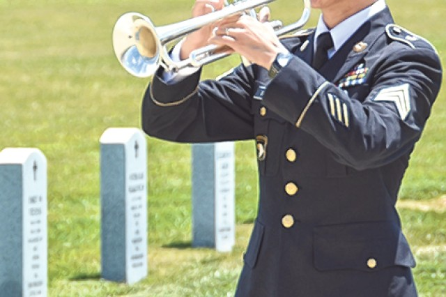 Sgt. Jason Taylor, 399th Army Band, plays Taps.