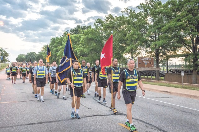 Brig. Gen. James Bonner, CBRN School commandant, leads the Dragon Soldiers prior to the start of the regimental run.