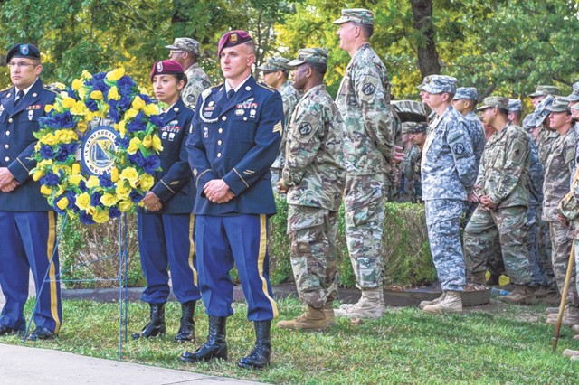 Soldiers wait to place the wreath during the Fallen Sunrise Service that paid honor to fallen Dragon Soldiers June 24 at the Chemical Memorial Grove.