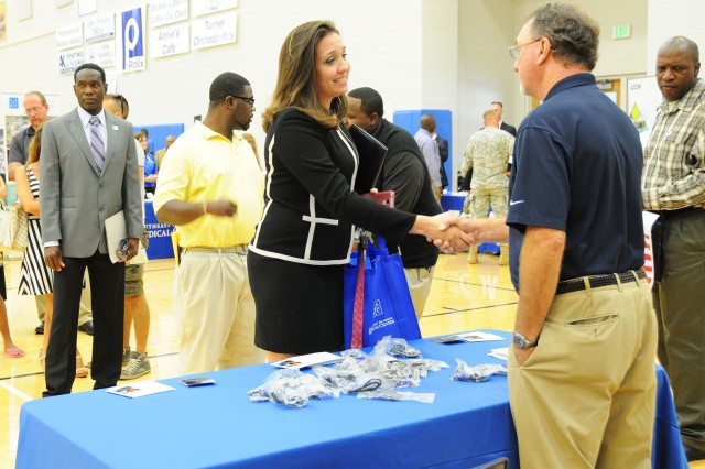 People line up to speak with Boeing representatives about employment opportunities during last year's job fair.
