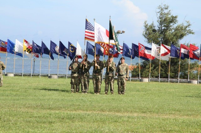 The 1st Battalion, 1st Special Forces Group assembled beneath the Okinawan sun on Border Landing Zone at Torii Station June 29 for a Change of Command Ceremony that bookmarked the latest chapter in the storied lineage of the unit.