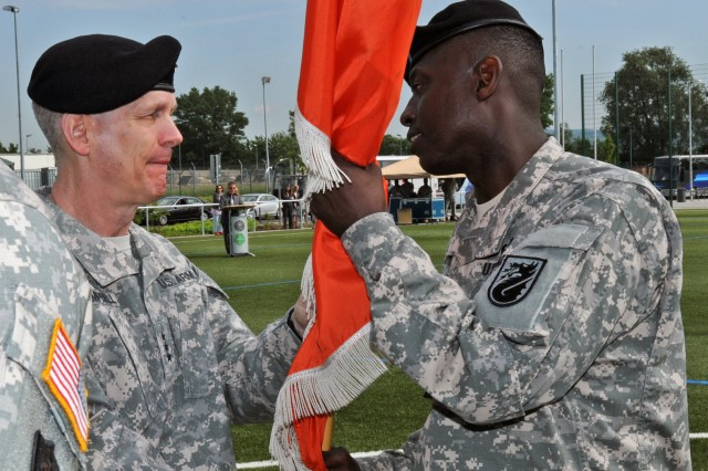 U.S. Army Europe Commanding General Lt. Gen. Donald M. Campbell (left), entrusts the colors and authority of 5th Signal Command to incoming commander Col. Jimmy L. Hall Jr. (right) in the presence of nearly 300 guests during a change of command ceremony May 19, 2004 at Newman Village Soccer Field on Clay Kaserne in Wiesbaden, Germany.