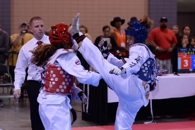 Spec. Monique Anderson, a combat medic stationed at Fort Hood, Texas, gets in a kick during her victory in the semi-finals at the U.S. Taekwondo Championships in Richmond,  Virginia.