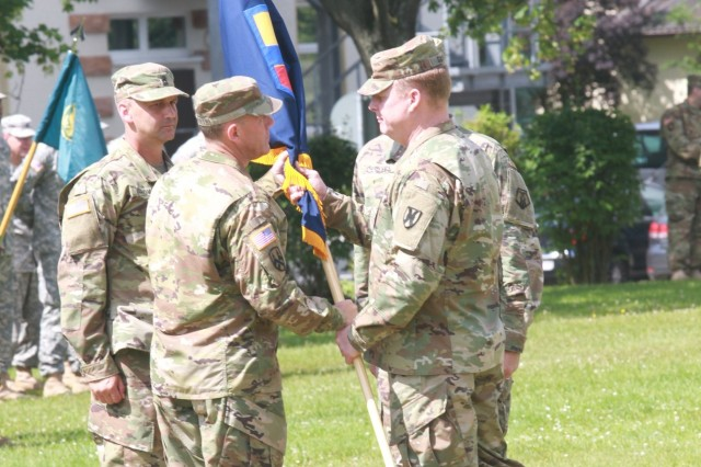 KAISERSLAUTERN, Germany-Maj. Gen. Duane Gamble, commanding general of the 21st Theater Sustainment Command (right) passes the 7th Mission Support Command guideon to Brig. Gen. Steven Ainsworth, the incoming commanding general of the 7th MSC  during the 7th MSC change of command ceremony Saturday, July 9, 2016 on Daenner Kaserne.