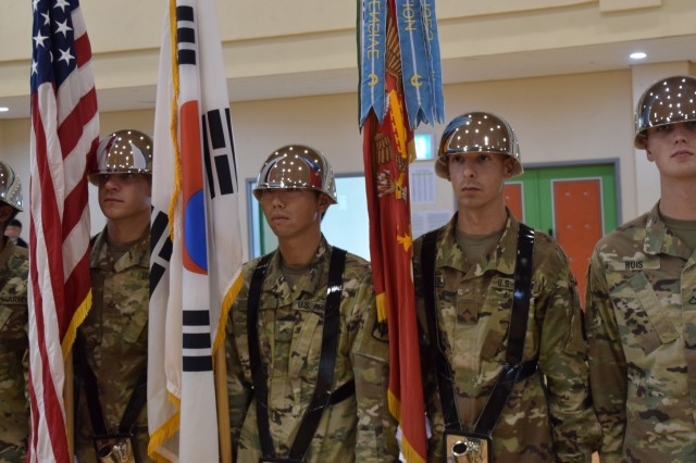 Members of 6th Battalion, 52nd Air Defense Artillery Regiment color guard stand tall during the change of command ceremony between outgoing commander, Lt. Col. Ethan Hall, and incoming commander, Lt. Col. Marc Pelini at Suwon Air Base, South Korea, July 7.