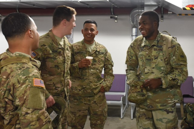 "Sgt. Xavier Glover, a 91B Wheeled Vehicle Mechanic, from Echo Company, 3rd Battalion, 501st Aviation Regiment, 1st Armored Division Combat Aviation Brigade, ""Task Force Apocalypse"" from Fort Bliss, Texas, relaxes with other 1AD CAB Soldiers in the terminal after arriving at Albrecht Dürer Airport, Nuernburg, Germany, July 4, 2016. The Soldiers from 1AD CAB are in USAREUR as an augmentation force to further enable the 12th Combat Aviation Brigade. (Capt. Jaymon Bell (12th Combat Aviation Brigade))"
