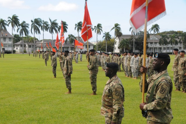 Soldiers of the 311th Signal Command (T) stand in formation during the change of responsibility, Fort Shafter, Hawaii on June, 2016. Command Sgt. Maj. Barlogio is the new Command Sgt. Maj. for the 311th Signal Command (Theater).