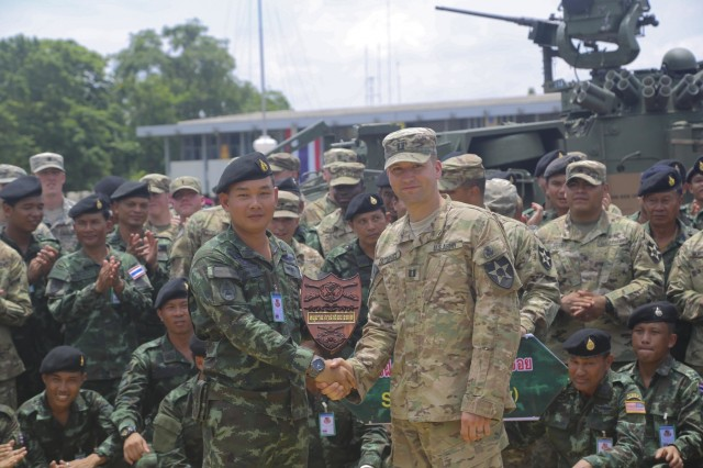 Soldiers from The U.S. Army and Royal Thai Army gather for the closing ceremony of Exercise Hanuman Guardian at Fort Adisorn, Thailand, July 8, 2016.