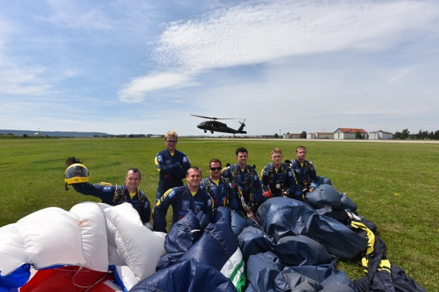 Soldiers from The Tigers Freefall Parachute Display Team, 1st Battalion, The Princess of Wales's Royal Regiment, pose for a picture with a UH-60 Black Hawk helicopter from 3rd Battalion, 227th Aviation Regiment, 1st Air Cavalry Brigade in the background, 8 July, near Illesheim, Germany.  The Tigers partnered with 3rd Bn., 227th Avn. Regt., in order to prepare for their upcoming freefall parachute performance at the Sunderland International Airshow.