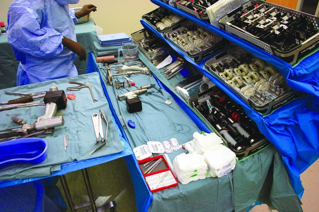 Eisenhower Army Medical Center is one of very few hospitals in the country and the only one in MEDCOM that employs a cantilevered shelving system that allows the assistant to see all of the instruments at a single glance, as seen during this orthopedic surgery June 28. There is also a touch-screen tablet that shows the operation step-by-step so the assistant can better anticipate the surgeon's needs.