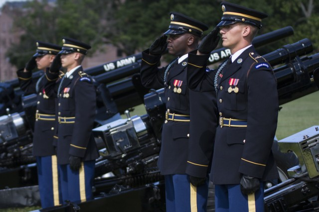 The 3rd U.S. Infantry Salute Guns Platoon renders a salute during the 200th Military Police Command's relinquishment of command ceremony at the McGlachlin Parade Field, at Fort Meade, Md., July 10, 2016. Lieutenant General Charles D. Luckey, chief of the Army Reserve and commanding general of the United States Army Reserve Command, was the reviewing official for the ceremony, in which Maj. Gen. Phillip M. Churn relinquished command to Brig. Gen. Marion Garcia.  (U.S. Army photo by Spc. Stephanie Ramirez)