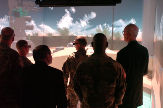 Gen. Daniel Allyn, Vice Chief of Staff of the Army, dons 3D active shutter glasses in the Cave Automatic Virtual Environment during a visit to the U.S. Army Tank Automotive Research, Development and Engineering Center, Warren, Mich., July 7, 2016. Gen. Allyn came to TARDEC, the leader for the Army's ground vehicle integration, to become familiar with its capabilities to include organic prototyping and autonomous operations. (Photo by Kimberly Bratic, TARDEC Public Affairs/Released)