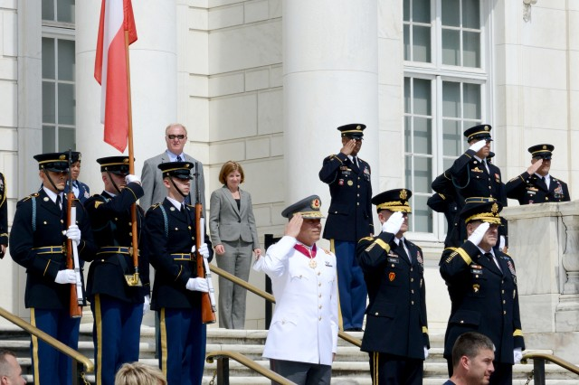 (left to right) Gen. Humberto Oviedo Arriagada, Chilean Army commander-in-chief, Maj. Gen. Bradley A. Becker, Joint Force Headquarters-National Capital Region/U.S. Army Military District of Washington commanding general, and Gen. Mark A. Milley, Army chief of staff, render honors during an Army Wreath-Laying Ceremony at the Tomb of the Unknown Soldier, Arlington National Cemetery, Virginia, July 12, 2016.