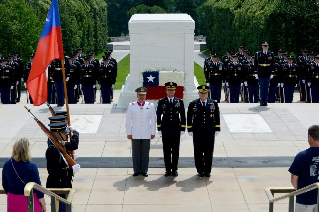 (left to right) Gen. Humberto Oviedo Arriagada, Chilean Army commander-in-chief, Maj. Gen. Bradley A. Becker, Joint Force Headquarters-National Capital Region/U.S. Army Military District of Washington commanding general, and Gen. Mark A. Milley, Army chief of staff, stand at attention during an Army Wreath-Laying Ceremony at the Tomb of the Unknown Soldier, Arlington National Cemetery, Virginia, July 12, 2016.