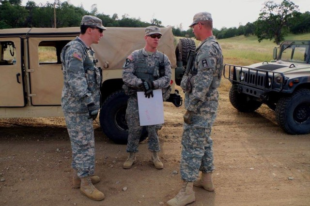 Sgt. 1st Class Erik Metcalf (right), an observer coach/trainer assigned to the 3rd  Battalion, 340th  Regiment (Brigade Engineer Battalion), 181st Infantry Brigade, discusses counter improvised explosive device and react to contact lane with Soldiers from the 2nd  Battalion, 378th  Regiment, 91st  Training Support Division at Fort Hunter-Liggett, California, May 11.