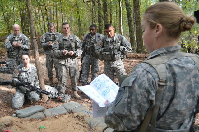Officer candidate Paulette Prince conducts a mission brief during a field exercise at Officer Candidate School, at Fort Benning, Georgia.