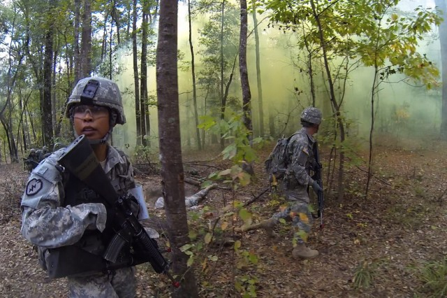 Officer candidate Paulette Prince leads her squad through unexpected enemy fire during a field exercise at Officer Candidate School, at Fort Benning, Georgia.