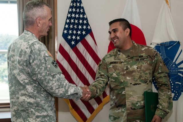Master Sgt. Elizandro Jimenez (right), an El Paso, Texas, native serving as an assistant inspector general, U.S. Army Japan (USARJ), shakes hands with Maj. Gen. James F. Pasquarette (left), commanding general, USARJ, at USARJ headquarters in Camp Zama, Japan, July 7, 2016. Pasquarette swore in Jimenez as the first Soldier in U.S. Army history to enter the IG ranks from the U.S. Army Chemical Corps. Jimenez's formal training and prior experience as a first sergeant will help provide a permanent IG presence for approximately 1,600 Soldiers stationed in Okinawa. (U.S. Army photo by Sgt. John L. Carkeet IV, U.S. Army Japan)